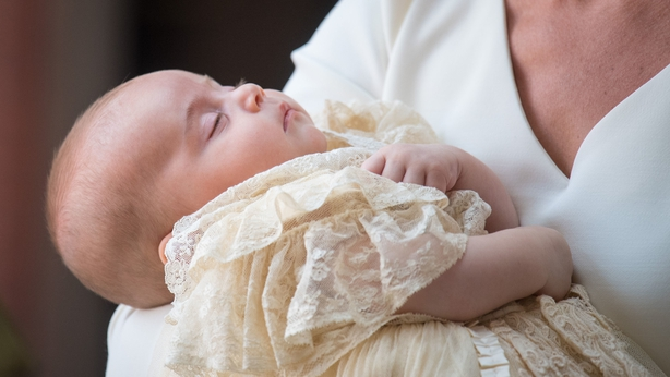 A sleeping Prince Louis was carried to his christening by his mother