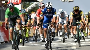 Colombia's Fernando Gaviria celebrates after crossing the finish line