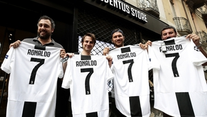 Put your shirt on him: Juventus fans show off their new purchases (€104.95 a pop)