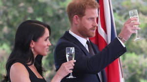 The royal couple offer a toast at the ambassador's residence