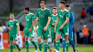 Cork City players dejected following the 1-0 defeat to Legia Warsaw