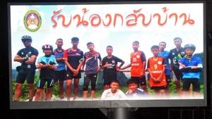 A billboard showing Coach Ekkapol Chantawong and his Wild Boars team