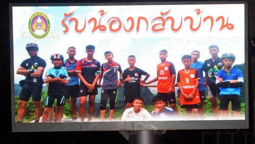 A billboard showing Coach Ekkapol Chantawong and his Wild Boars team