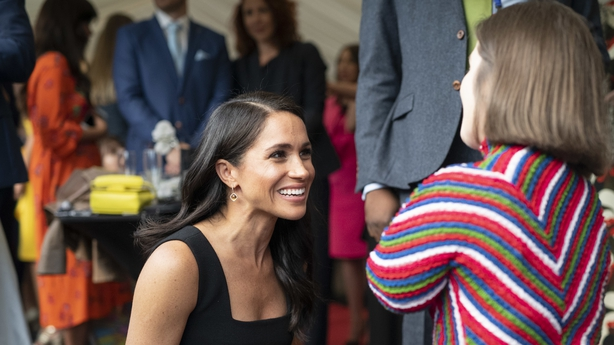Markle chatting with Sinéad Burke
