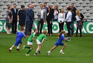 The Duke and Duchess of Sussex watch children demonstrate their football skills at Croke Park