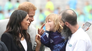 Three-year-old Walter Cullen has some fun with the couple
