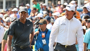Tiger Woods (L) and Phil Mickelson are set for a winner-takes-all shootout