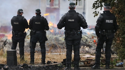 PSNI officers at the site of a bonfire in the Bloomfield Avenue area of Belfast