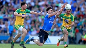 Michael Darragh McAuley of Dublin with Martin McElhinney of Donegal in action during the 2016 quarter-final between the sides
