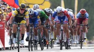 Dylan Groenewegen leads home the riders on stage seven