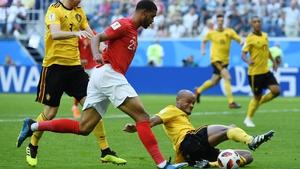 England's midfielder Ruben Loftus-Cheek fights for the ball with Belgium's Vincent Kompany