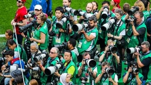 Photographers vie for the best position as the teams emerge