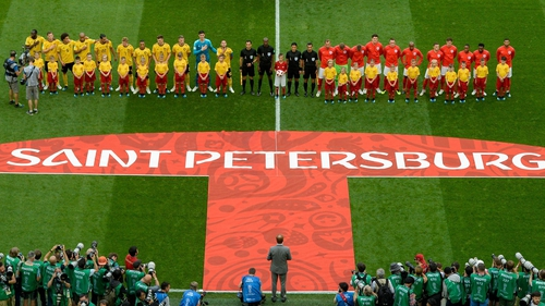 Belgium and England players line up for the national anthems