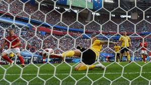Belgium's defender Toby Alderweireld clears a shot on goal by England's Eric Dier