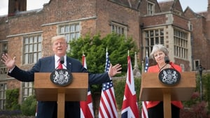 Theresa May said Donald Trump advised her to sue the European Union over Brexit