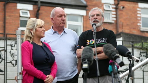 Michelle O'Neill, Bobby Storey and Gerry Adams on stage at the event