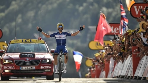 Julian Alaphilippe crosses the line to take stage victory