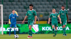 Jimmy Keohane and his Cork City team-mates dejected after conceding the opening goal against Legia Warsaw