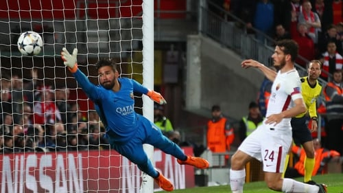 Alisson on action for Roma against the Reds in last season's Champions League