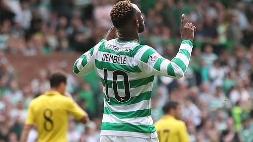 Moussa Dembele celebrates his penalty