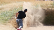 Rory McIlroy found himself in the sand after his first drive