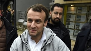 A preliminary investigation has been launched against Alexandre Benalla (seen here behind Emmanuel Macron)