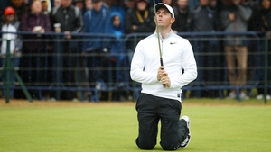 McIlroy reacts to a missed putt at the last
