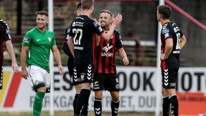 Daniel Kelly celebrates his second goal with Keith Ward