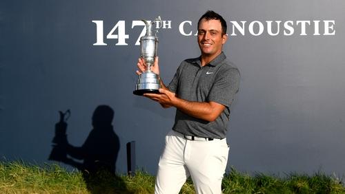 Francesco Molinari hoists the famous Claret Jug following his Open success