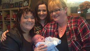 Brenda meets baby Oisin, just 8 days old