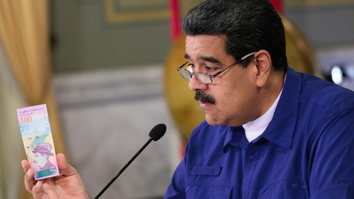 Mr Maduro showing new denomination notes that are to be released next month