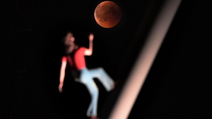 Eclipse is pictured with a sculpture by artist Jonathan Borofsky 'Woman walking to the sky' in Strasbourg