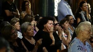 Mourners at a church service in Mati