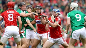 Cork and Limerick players scrap for possession