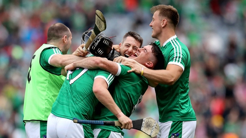 Relieved and delighted Limerick players celebrate at the final whistle