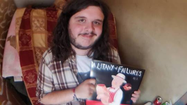 Stevie Lennox with a copy of his new compilation A Litany Of Failures.