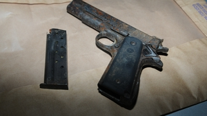 A semi-automatic Luger pistol containing ten rounds of ammunition was found in the car