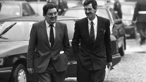 Laughing as he walks with then Labour leader Dick Spring to the inauguration of Mary Robinson in 1990
