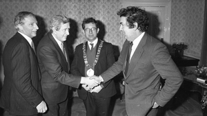 Garret FitzGerald shakes hands with John Hume at the launch of 'John Hume: Statesman of the Troubles' in Dublin in 1985