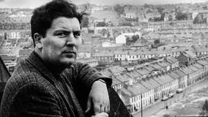 John Hume pictured on a rooftop overlooking Derry's Bogside in 1970