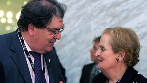 Mr Hume chats to former US Secretary of State Madeleine Albright at a conference in Madrid in 2005