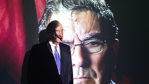 Former US peace envoy to Northern Ireland George Mitchell in front of a John Hume picture at Hugh Lane Gallery in Dublin in April 2018