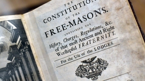 A book by James Anderson titled 'The Constitutions of the Free-Masons' dated 1723