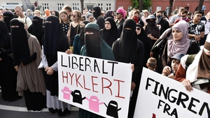 Face covered women protest in Copenhagen on the first day of the implementation of the Danish face veil ban