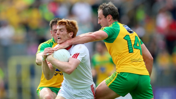 Tyrone's Peter Harte tackled by Michael Murphy for Donegal