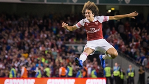Matteo Guendouzi celebrates winning after Alex Iwobi scores the winning penalty