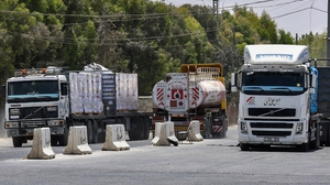 Trucks at the Kerem Shalom crossing in Rafah, the main passage point for goods entering Gaza from Israel