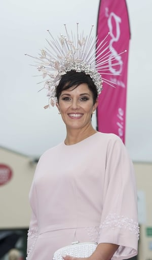 Suzanne Burke wore a soft blush pink with a striking headpiece.