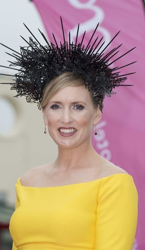 Tara Lally shone in yellow. We love that she chose a black hairpiece to stand out from the crowd.