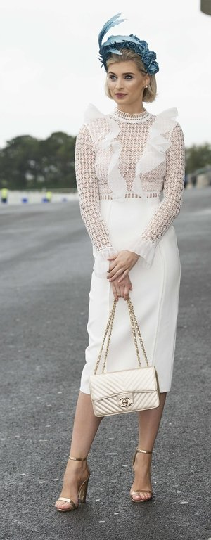 Katie Geoghegan looked every bit the lady in a white dress and beautiful blue headpiece. Check out that Chanel purse!